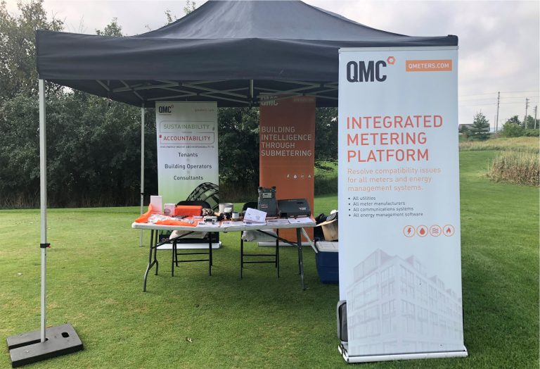 Image of QMC's booth at the IFMA golf event