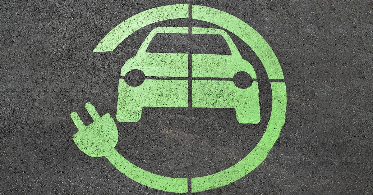EV capable stall, with green EV logo around an image of an EV vehicle.