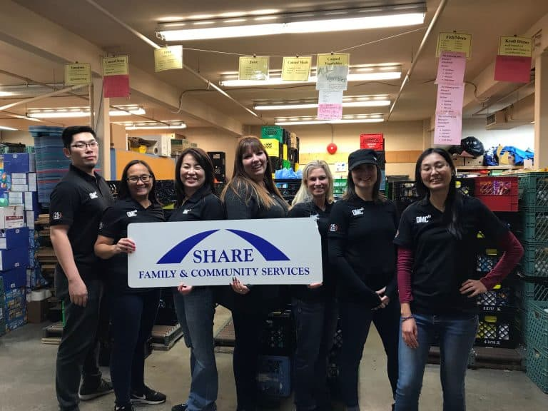 QMC staff volunteering their time at Share Food Bank